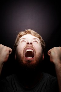 an angry man screaming